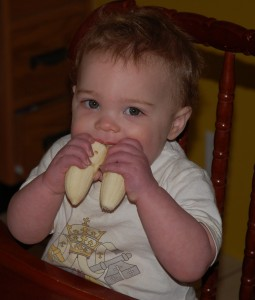 C is showing us the best way to eat a banana!