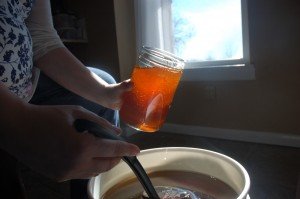 Baby and bottling the honey.