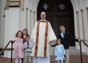 Rev. Mr. Wright with the Facemyer kids at the Cathedral of St. John the Baptist in Savannah, Georgia